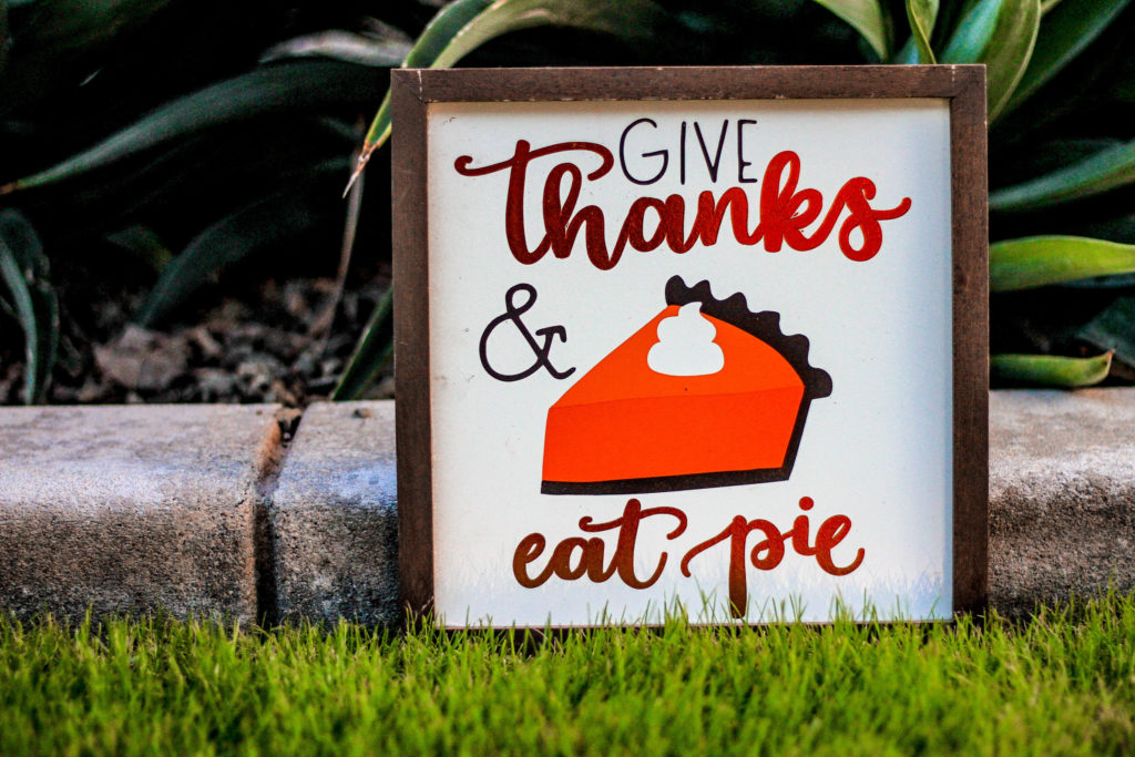 Picture of a poster with a piece of pumpkin pie that says Give Thanks Eat Pie